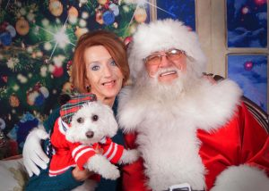 RSD CRPS warrior Shannon takes time to sing her song to santa with dog Finian.