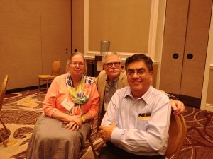 RSDSA's executive vice president, director Jim Broatch with doctors Terri Lewis and Pradeep Chopra. All work towards CRPS progress